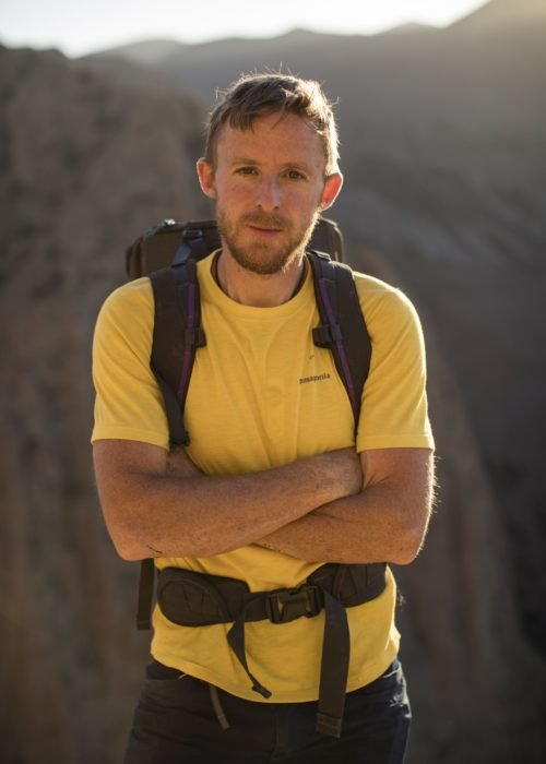 Tommy Caldwell poses for a portrait after just climbing to the top of Tadrarate via a 500m, 7c+ climbing route. He's climbing with Alex Honnold in Taghia, Morocco. September 20th, 2016.